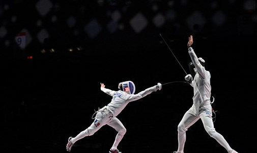 Silver Medalist Siculus, defeating one of the French at the women's hand - Olympics, day two