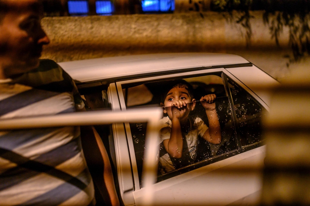 afp.19.10.09. A boy looks from a car as they prepare to leave after a mortar sent from Syrian side hit their house in Akcakale in Sanliurfa province on October 9, 2019. - Turkey has launched a broad assault on Kurdish-controlled areas in northeastern Syri