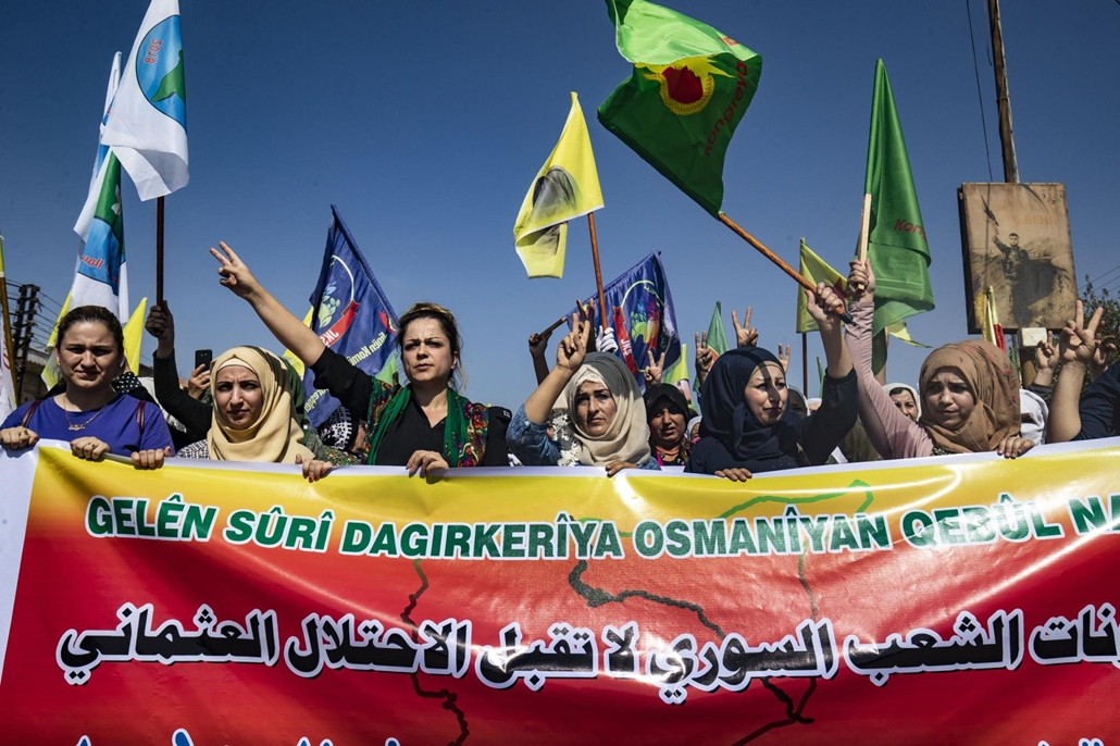 afp.19.10.09. Syrian Kurds take part in a demonstration against Turkish threats in Ras al-Ain town in Syria's Hasakeh province near the Turkish border on October 9, 2019.