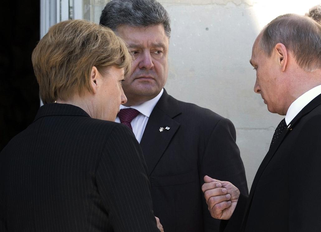 afp.14.06.06. - Bénouville, Franciaország: Angela Merkel, Vlagyimir Putyin, Petro Porosenko a D-nap évfordulóján
