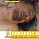 Megjelent az első fotó a véres fejű Kadhafiról