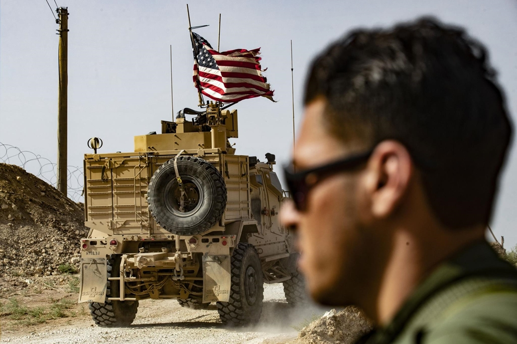 afp.19.10.06. US-led international coalition on the outskirts of Ras al-Ain town in Syria's Hasakeh province near the Turkish border on October 6, 2019. - US forces in Syria started pulling back today from Turkish border areas, opening the way for Ankara'