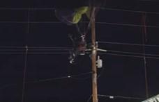 Három órát lógott egy sárkányrepülős a villanyoszlopon