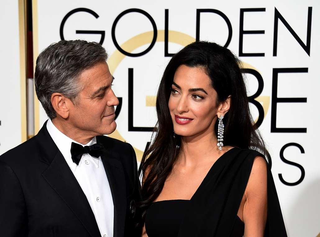afp. Golden Globe, Arany Glóbusz, 2015.01.11. Beverly Hills, EGyesült Államok, Actor George Clooney (L) and Amal Clooney arrive on the red carpet for the 72nd annual Golden Globe Awards, January 11, 2015 at the Beverly Hilton Hotel in Beverly Hills, Calif