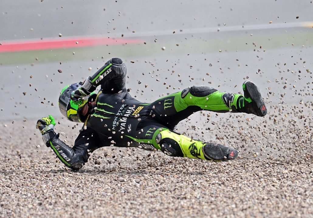 afp. az év sportfotói 2014. Hohenstein-Ernstthal, Németország, 2014.07.12. Yamaha rider Pol Espargaro of Spain crashes during the training session of the MotoGP of the Grand Prix of Germany at the Sachsenring Circuit on July 12, 2014 in Hohenstein-Ernstth
