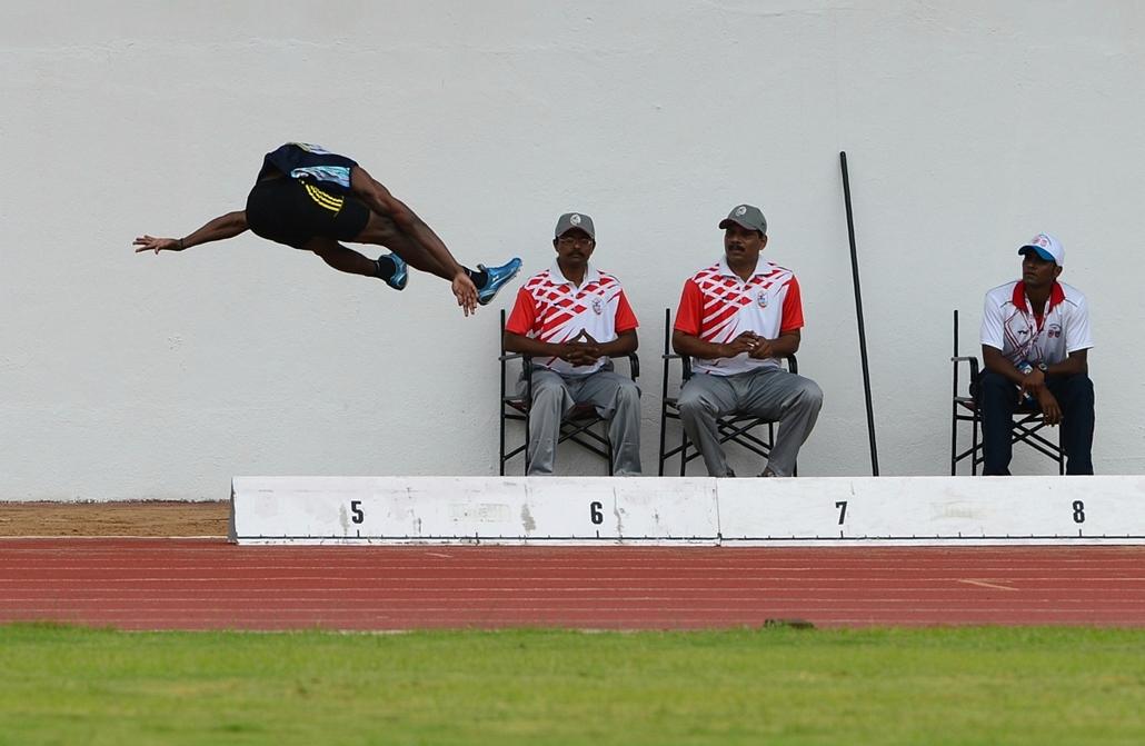 13.07.03. - Pune, India: az indiai Dileep Kumar K. ugrása az öt napos ázsiai Atlétikai bajnokság első napján - évképei, az év sportképei